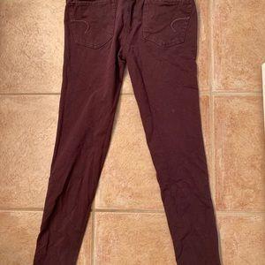A maroon skinny jean
